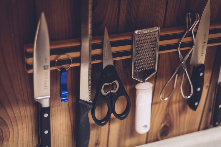 Scissor Arrangement Brown Cheese Grater Choice Close-up Equipment High Angle View Indoors  Knives Large Group Of Objects Man Made Man Made Object Metal Music No People Scissors Selective Focus Still Life Table Variation Wood - Material