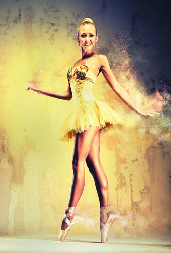 Beautiful ballerina in yellow tutu on point. Image with a digital effects Ballerina Effects & Filters Performer  Sand Effect Woman Ballet Ballet Dancer Beautiful Woman Blond Hair Caucasian Creative Dancer Digital Digital Art Digital Art Photo Digital Artwork Digitally Generated Digitally Generated Image Female Flexibility Girl People Sandstorm Young Adult Young Women