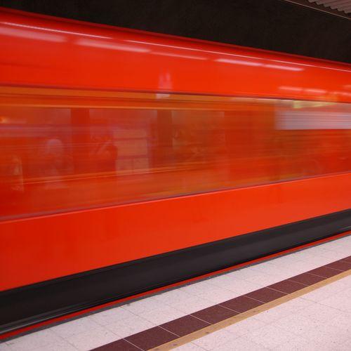 Blurred motion of train at railroad station platform