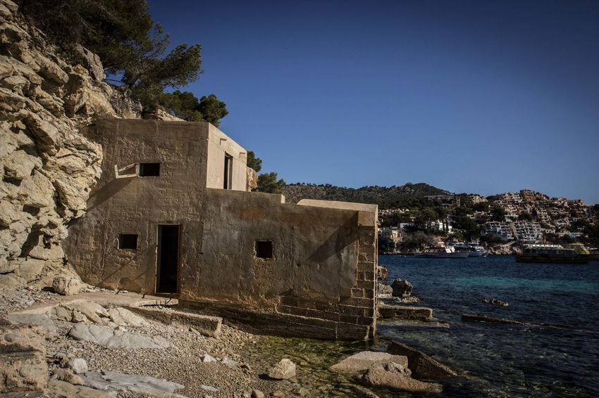 Ancient Civilization Architecture Boathouse Boathouses Building Exterior Built Structure Clear Sky Day Forgotten Boathouse Forgotten Places  History Lost Place Mallorca No People Old Ruin Outdoors Rock - Object