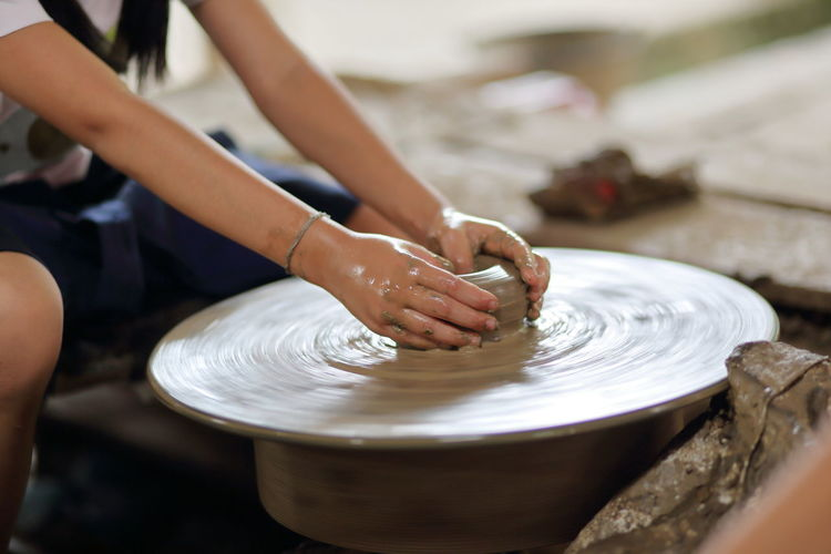 The activity clay pot uses hand workshop mold Ancient Thailand. Art And Craft Clay Craft Creativity Design Education Expertise Focus On Foreground Hand Human Body Part Human Hand Indoors  Making Molding A Shape Motion Mud Occupation One Person Pottery Real People Skill  Spinning Vintage