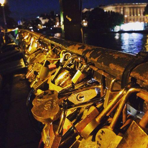 Love bridge in Paris with slots Love Bridge Paris Slots Tourist Travel Scenery Night City Life Focus On Foreground No People Vacations