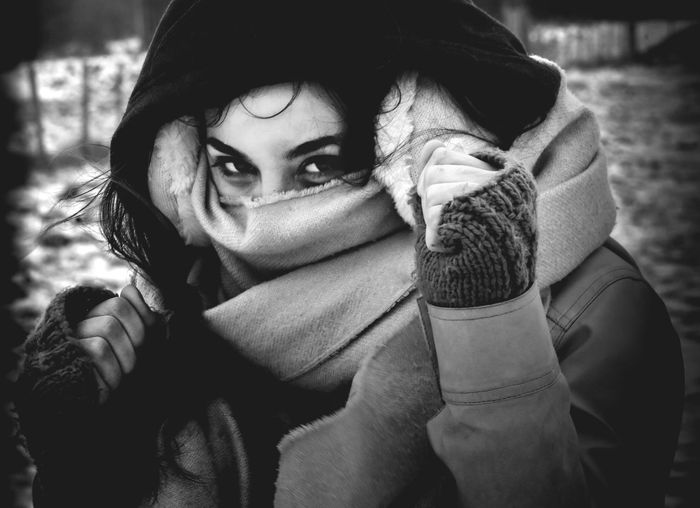Adult Beautiful Woman Clothing Contemplation Covering Focus On Foreground Front View Headshot Hood - Clothing Leisure Activity Lifestyles Looking At Camera One Person Portrait Real People Scarf Warm Clothing Winter Women Young Adult Young Women