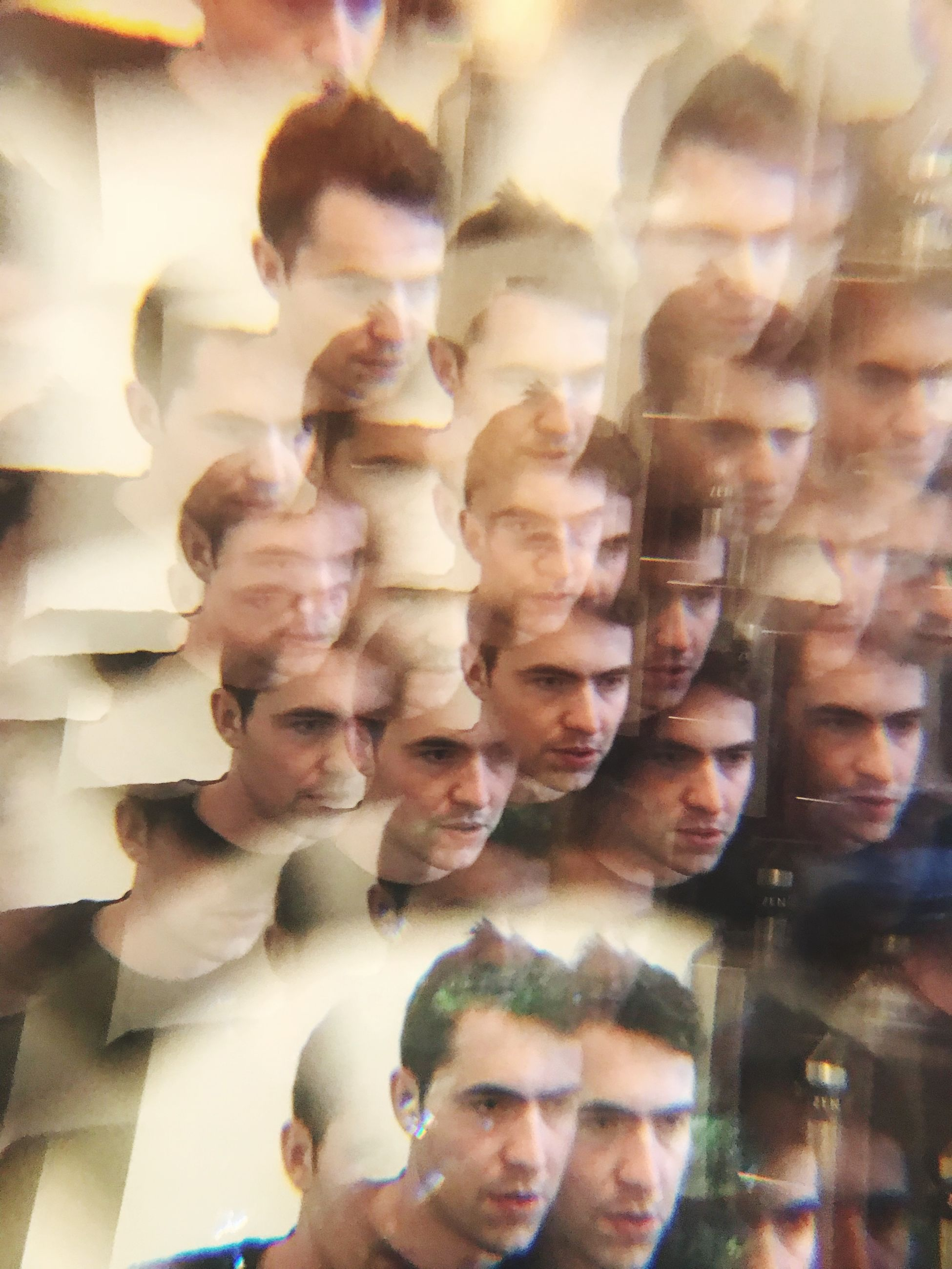 group of people, men, real people, crowd, indoors, young men, large group of people, adult, togetherness, glass - material, lifestyles, portrait, happiness, looking, reflection, women, mature adult, business, digital composite