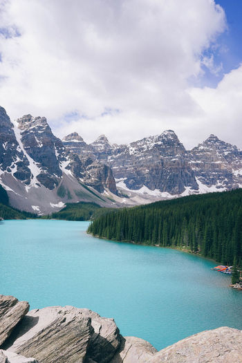 Moraine Lake, Canada Mountain Sky Water Scenics - Nature Beauty In Nature Mountain Range Tranquil Scene Tranquility Nature Non-urban Scene Day Lake No People Outdoors Formation Canada Banff National Park  Bare Tree Alberta Terquoiseblue Blue Lagoon Blue Lake