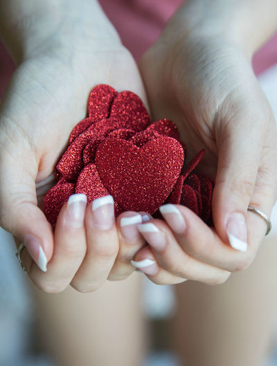Hands holding red glitter hearts Care Glitter Red Giving Hands Cupped Heart Heart Shape Holding Human Body Part Human Hand One Person Palm Philanthropy Red Valentines Day