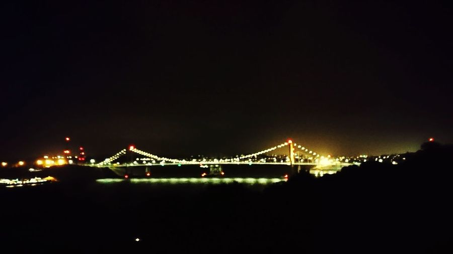 Paint The Town Yellow Bridge - Man Made Structure Night Celebration Travel Destinations Illuminated Connection Outdoors City Suspension Bridge Sky Built Structure Cityscape No People Architecture
