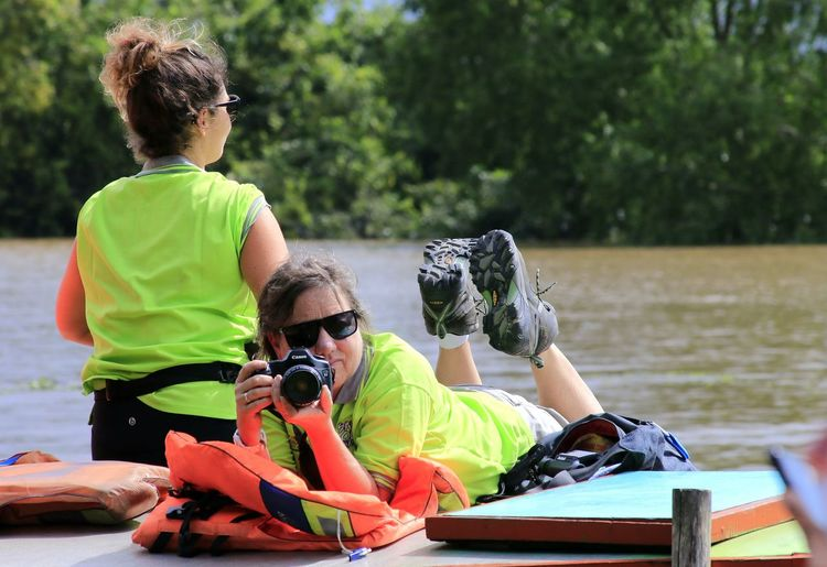 Stay on the boat Capture Tomorrow Water Togetherness Friendship Young Women Adventure Teamwork City Sport Sitting Sports Clothing Life Jacket