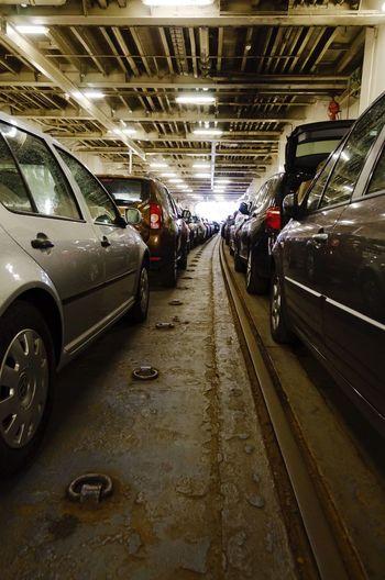 Cars moving on illuminated underground walkway
