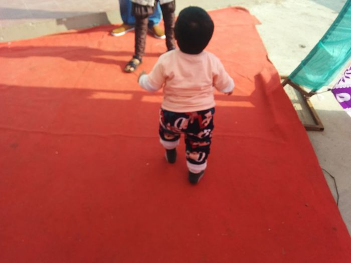 Childhood Child Playground Playing Two People Children Only Girls People Rear View Outdoors Full Length Fun Leisure Activity Boys Real People Day Togetherness Males  Adult Little Boy Running On Red Carpet