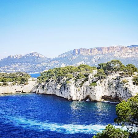 EyeEm Selects Mountain Landscape Scenics Nature Beauty In Nature Sky Rock - Object Tranquility No People Clear Sky Blue Mountain Range Water Mountain Peak Outdoors Travel Destinations Cliff Outdoor Marseilles Cassis Cassislescalanque CalanquesDeCassis Calanques
