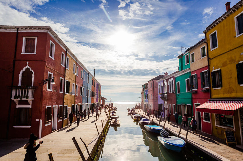 All those colors of Burano Travel Travel Photography Architecture Building Exterior Built Structure Burano Cloud - Sky Day Gondola - Traditional Boat Mode Of Transport Moored Nature Nautical Vessel No People Outdoors Sky Sunlight Transportation Travel Destinations Venezia Italia Venice Water Adventures In The City