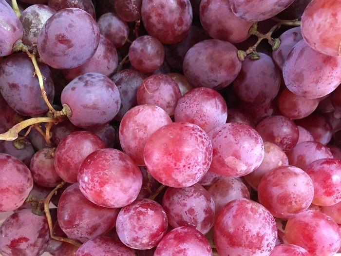 Full Frame Shot Of Red Grapes At Market