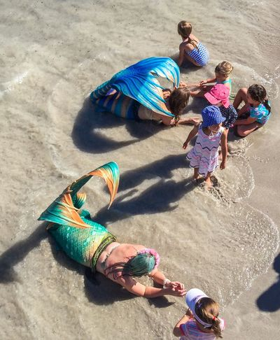 Mermaids Sand Recreation  Fun Coogee, WA April 3,2016 Families Incidental People Entertainment Mermaids Festival Event Indian Ocean Beach Western Australia Coogee Beach Festival Performers Scales Costumes Interactive  Children Kids Touch And Feel Tails Outdoors Activity