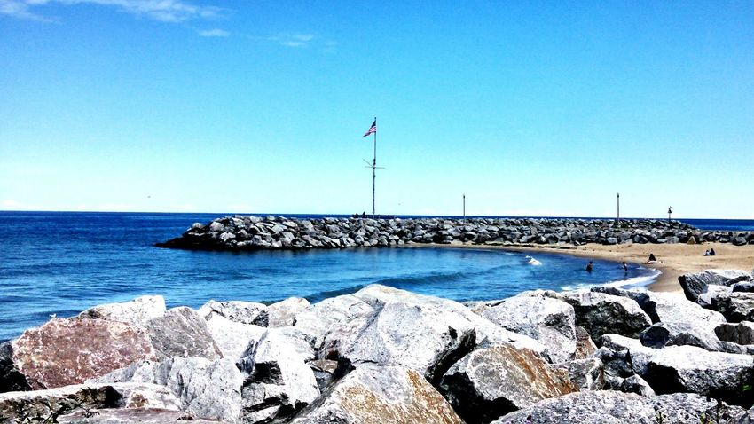 Lake Michigan Oak Creek Wisconsin Beach Flag Flag Pole USA Landscapes Rocks And Water Rocks Landscapes With WhiteWall Landscapes With White Wall Landscape Nature The KIOMI Collection Blue Wave