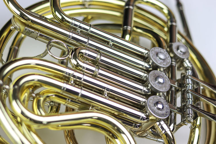 Music Instrument French horn Metal Music Musical Instrument Close-up Arts Culture And Entertainment Indoors  No People Brass Instrument  Gold Colored Studio Shot Shiny Brass Wind Instrument Focus On Foreground Still Life White Background Musical Equipment Trumpet Cut Out Silver Colored Marching Band