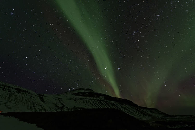 Low Angle View Of Aurora Borealis At Night During Winter