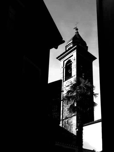 Parrocchia Cattolica S. Antonio Abate, Vittà Vecchia Locarno (old town Locarno) Architecture Bnw Bnw_captures Building Exterior Built Structure Church Church Tower Cloud - Sky Cloudy Day Day Historical Building Low Angle View No People Old Town Outdoors Palm Tree Shadow Shadow And Light Shadows & Lights Switzerland