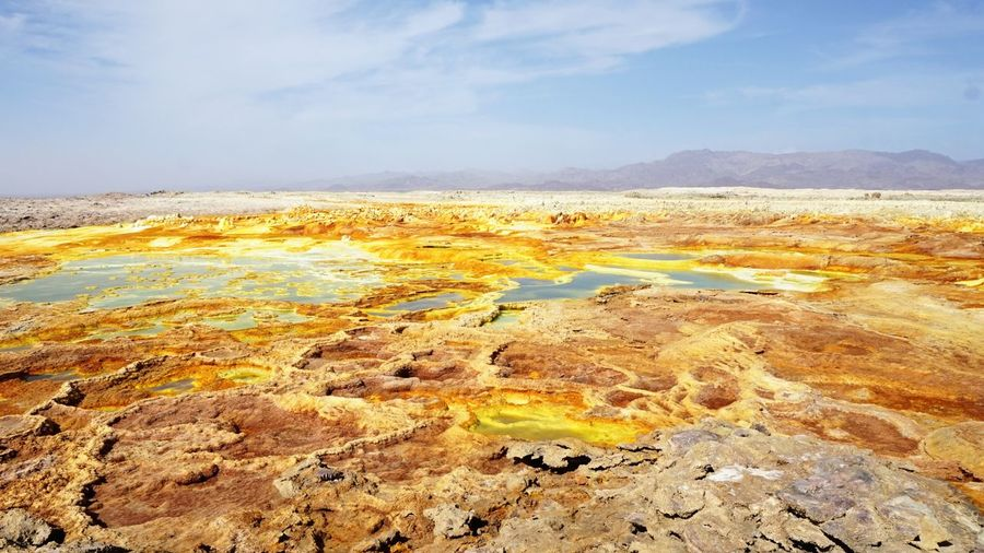 Volcanic acid terrain around Danakil Depression, Dalol Ethiopia Travel Photography Travel Destinations Volcanic Landscape Geologyporn Afar Danakil  Danakil Depression Ethiopia Sky Beauty In Nature Tranquil Scene Tranquility Scenics - Nature Cloud - Sky Nature Landscape Physical Geography Environment Geology Hot Spring Remote Land Mountain