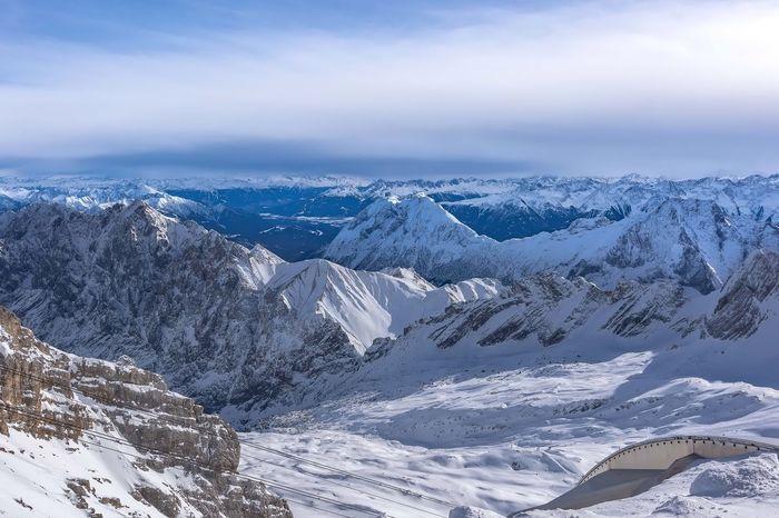 Zugspitze, höchster Berggipfel der Bundesrepublik Deutschland und des Wettersteingebirges in den Ostalpen. Winter Snow Tranquil Scene Tranquility Cold Temperature Scenics Beauty In Nature Nature Sky Tourism Mountain Ski Lift Landscape Outdoors Day