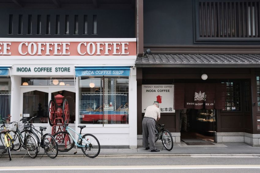 Text Bicycle Architecture Building Exterior Communication Built Structure Day Store Real People Outdoors Men City Politics And Government Adult People Street Photography Streetphotography Inoda Coffee