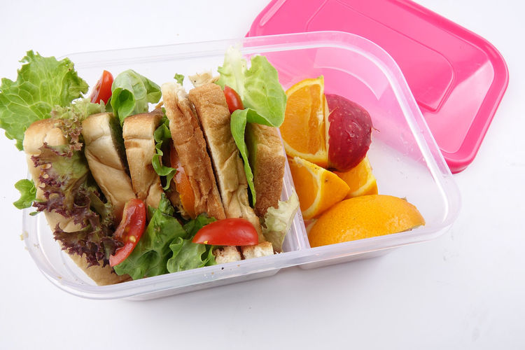 HEALTHY LUNCH BOX ISOLATED ON WHITE Close-up Eating Utensil Food Food And Drink Freshness Fruit Healthy Eating High Angle View Indoors  Kitchen Utensil Lunch Box No People Plate Ready-to-eat Serving Size Snack Still Life Studio Shot Table Temptation Tomato Tray Vegetable Wellbeing