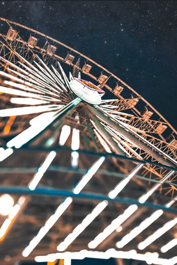 THE WHEEL Lacountyfair Ferris Wheel Ferris Wheel At Night EyeEm Selects Night Architecture No People Built Structure Illuminated City Star - Space Transportation Building Exterior Motion Pattern Travel Destinations Space Long Exposure Outdoors Connection Nature Low Angle View Sky