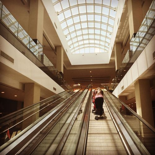 Dramatic Angles Indoors  Girl Stroller Escalator Structure Up