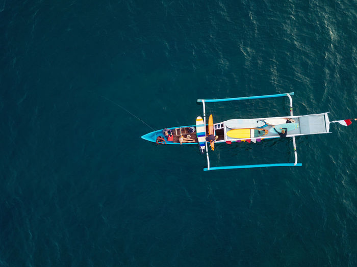 High angle view of men sailing in sea