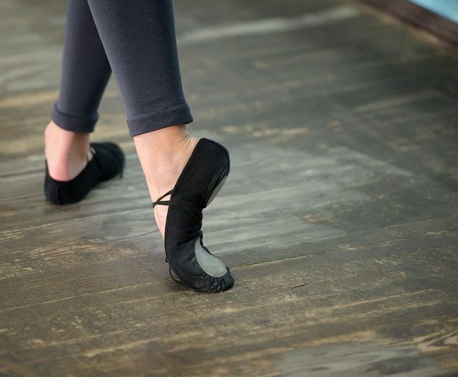 Low Section Of Ballet Dancer Practicing On Hardwood Floor