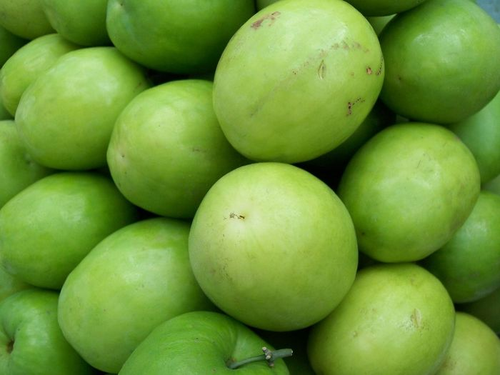 Full Frame Shot Of Green Apples For Sale At Market