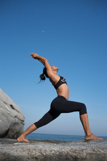 Balance Beauty In Nature Blue Clear Sky Day Exercising Full Length Healthy Lifestyle Leisure Activity Lifestyles Nature One Person Outdoors People Real People Scenics Sea Sky Water Yoga Young Adult Young Women