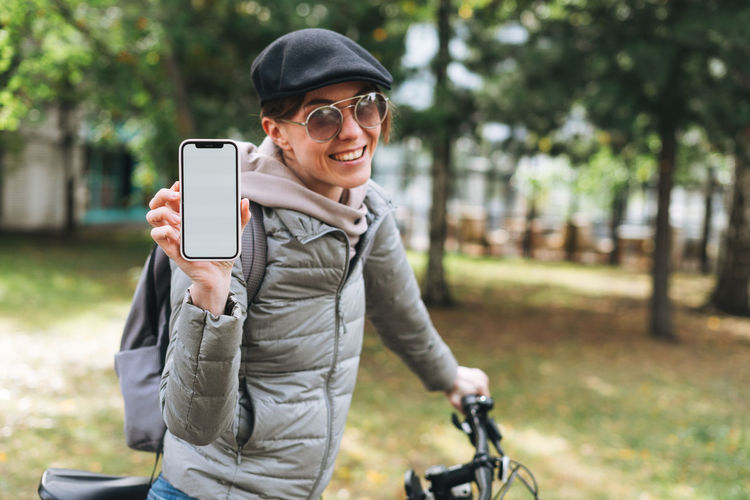 Portrait of smiling young man using smart phone