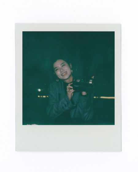 Portrait of happy woman photographing