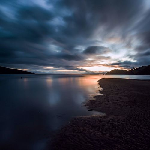 Colville bay against cloudy sky at sunset