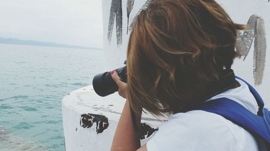 Close-up of woman photographing sea
