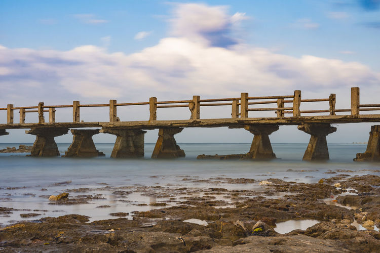 Some day Bridge Old Bridge Wrecks Abandoned Falling Apart Water Sea Beach Horizon Sky Horizon Over Water Landscape Cloud - Sky Seascape Low Tide Tide Coastline Coastal Feature Coast Shore
