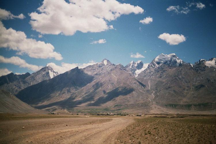 Idyllic shot of dirt road against himalayas at ladakh