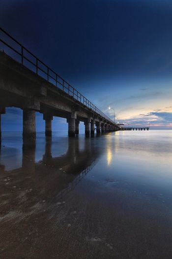 Color Of Sunset Connection Bridge Architecture Bridge - Man Made Structure Built Structure Water Transportation Sky Sea Nature No People Night Reflection Architectural Column Illuminated Travel Destinations Scenics - Nature City Long