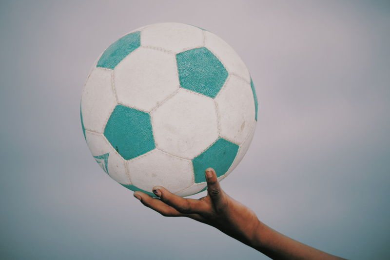 Close-up of hand holding ball