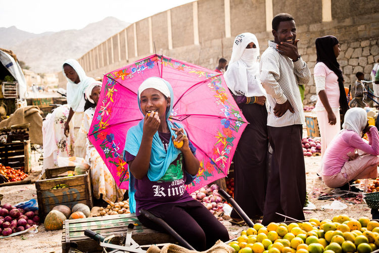 the pink umbrella Africa Beautiful Moment Day Enjoyment Eritrea Eritrean Girl Fruit Market Hope Hopeful Market Marketplace Oppressive Outdoors People Pink Pink Umbrella Remote Location Simple Beauty Smiling Tourism Umbrella Millennial Pink
