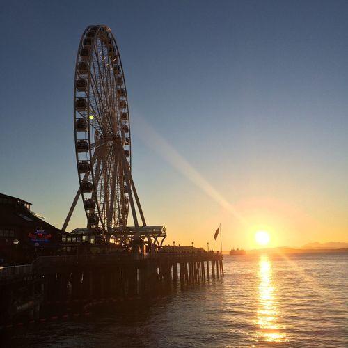 Seattle Great Wheel At Pier 57 On Elliott Bay During Sunset
