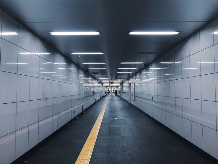 Minimalism Symmetrical Perspective Underground Passage Reflection Japan Tokyo The Way Forward Transportation Direction Diminishing Perspective Architecture Lighting Equipment Ceiling Illuminated Sign Indoors  Built Structure Tunnel No People Empty Wall - Building Feature Road Symbol Road Marking Marking Light The Architect - 2018 EyeEm Awards #urbanana: The Urban Playground