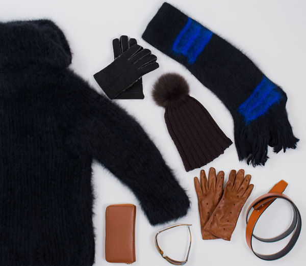 Winter fashion accessories in Flat Lay Still on white Angora Shawl Cut Fashion Isolated Winter Accessories Angora Sweaters Belts Flat Lay Gloves Leather Gloves Purse Scarf Sunglasses Warm Woolen Hat