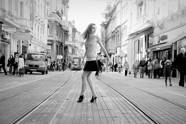 Fashionable young  woman crossing the street