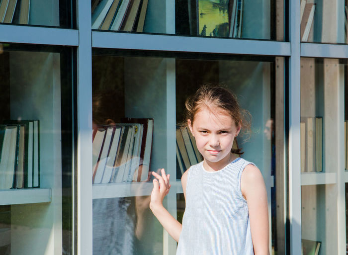 Casual Clothing Child Childhood Day Emotion Front View Girls Glass - Material Hairstyle Innocence Leisure Activity Lifestyles One Person Outdoors Portrait Real People Standing Waist Up Window Women