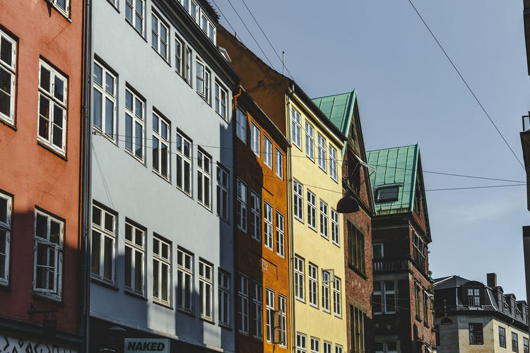 Copenhagen, Denmark Apartment Architecture Blue Building Building Exterior Built Structure Cable City Clear Sky Copenhagen Day Glass - Material In A Row Low Angle View Nature No People Outdoors Residential District Row House Side By Side Sky Sunlight Window