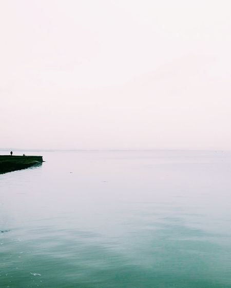 Tranquility Beauty In Nature Reflection Water Sky Horizon Over Water Landscape Idyllic Standing Water Sea Sunset Tranquil Scene Non-urban Scene Scenics Nature Business Finance And Industry Outdoor Pursuit Blue Outdoors Beach Mobilephotography Minimalism Minimal_perfection Minimal_people