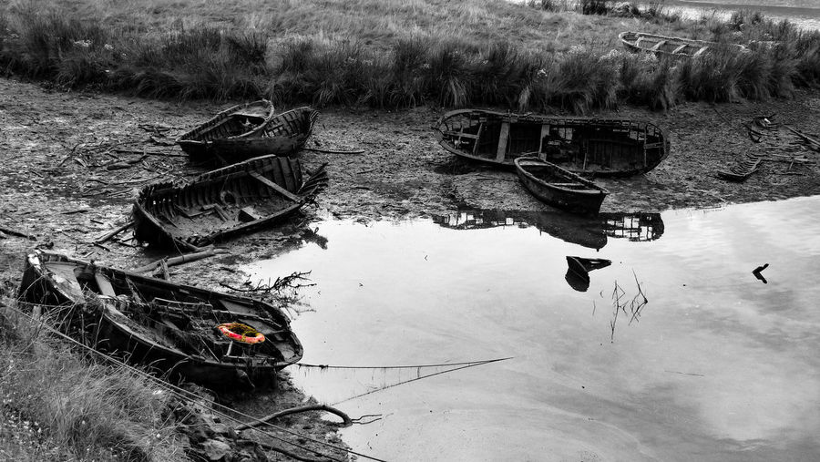High angle view of abandoned boats moored on lake