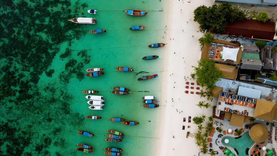 Directly above shot of boats moored on beach